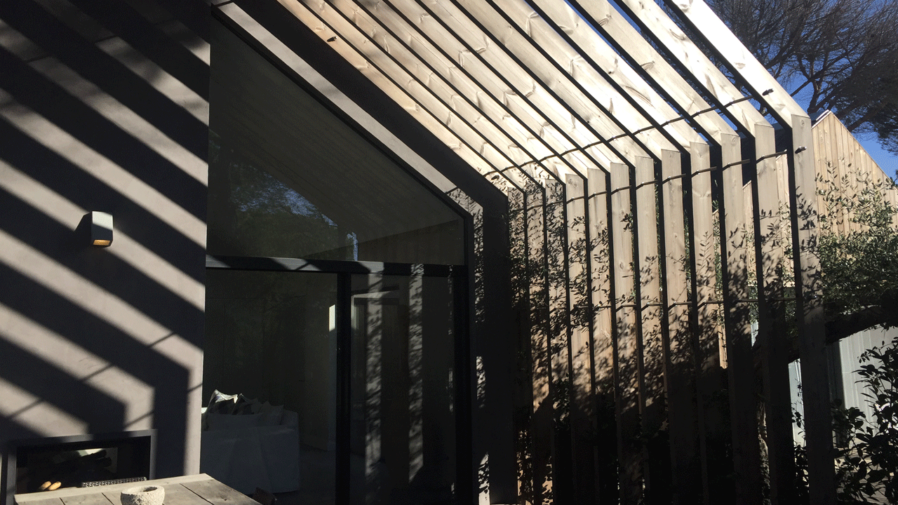 Dappled light on a terrace at Sublime Comporta